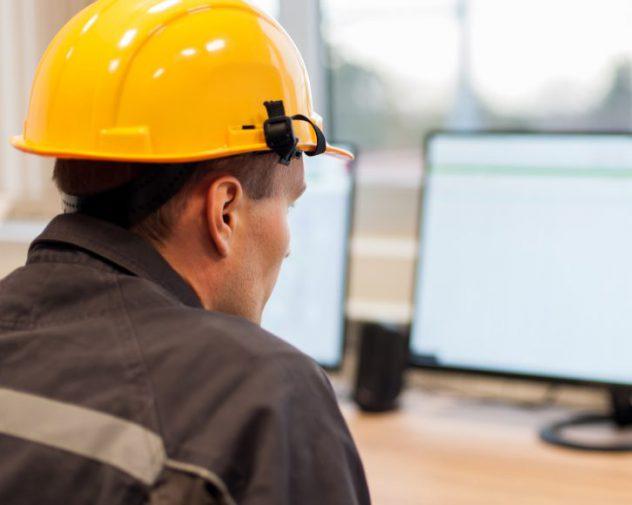 Engineer at computer working with AutoCAD Marine Engineering jobs